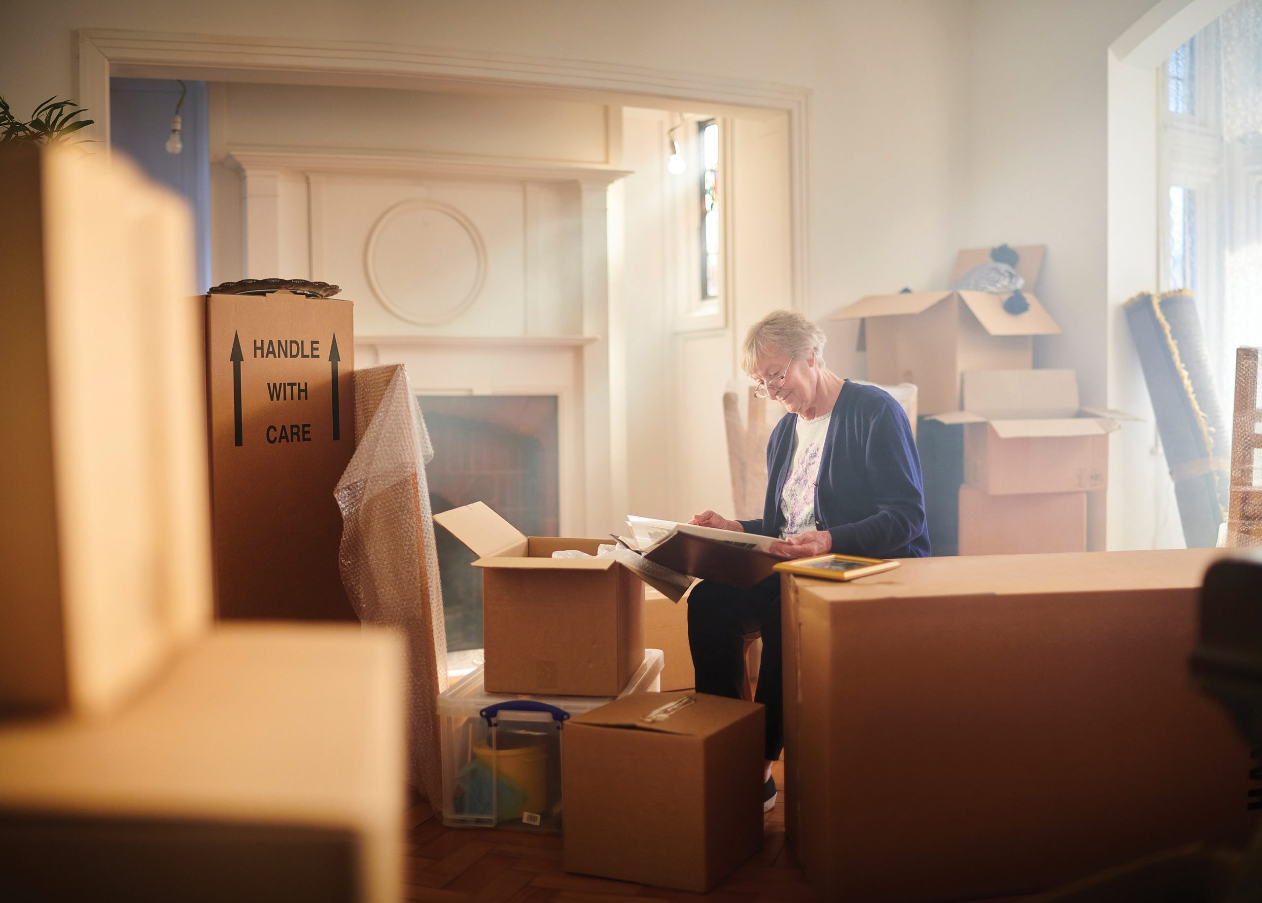 Senior citizen packing boxed in her home preparing for a move